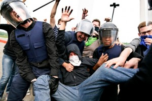 A protester arrested by riot police