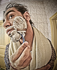 "A man shaving, by Flickr user ""joodi"", licensed via Creative Commons"