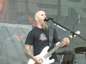"Scott Ian rockin so hard, from Flickr user ""LaSombra"", licensed via Creative Commons"