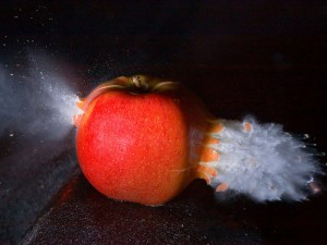 "Bullet through an apple, by Flickr user ""nebarnix"", licensed via Creative Commons."