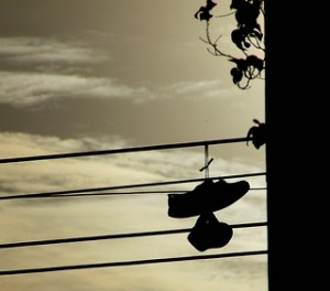 Shoes hanging, by Flickr user will ockenden, licensed by Creative Commons