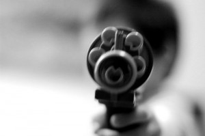 gun by Flickr user Gideon Tsang, licensed by Creative Commons
