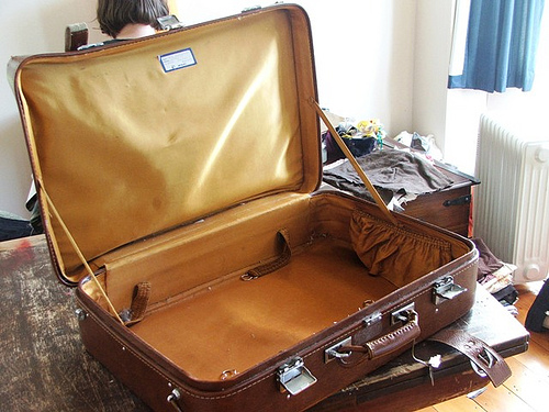 This is an open suitcase by Flickr user emmamccleary, licensed by Creative Commons