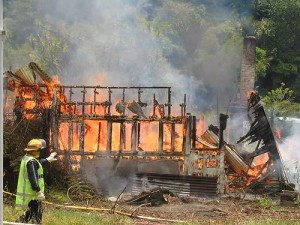Burned Down House by Flickr user Kiwi NZ, licensed by Creative Commons