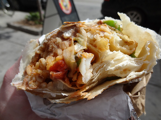 fried fish burrito, by Flickr user theCSSdiv, licensed by Creative Commons.