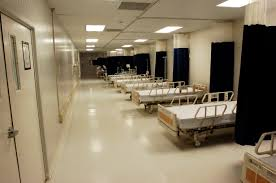 Hospital beds, by Wikimedia user Joseph Scozzari, licensed by Creative Commons.
